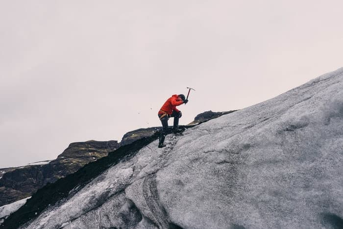 Ice climbing with axe