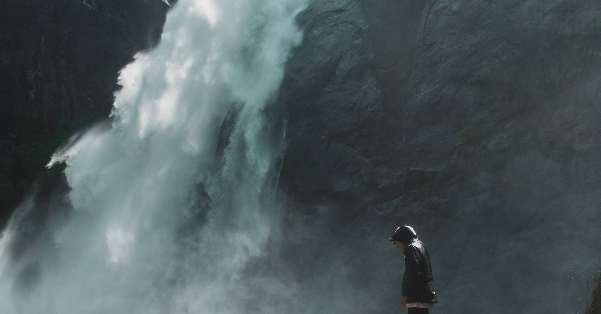 A man riding on the back of a waterfall