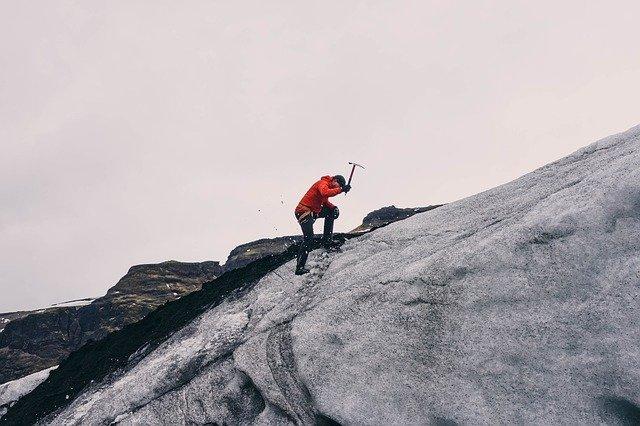 A man riding on top of a mountain