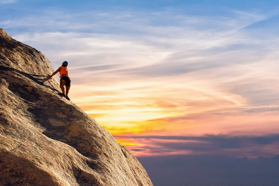 A man standing on a rocky hill