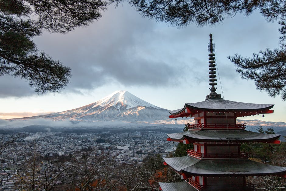 A large body of water with Mount Fuji in the background