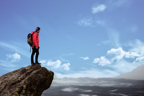 A man standing on top of a mountain