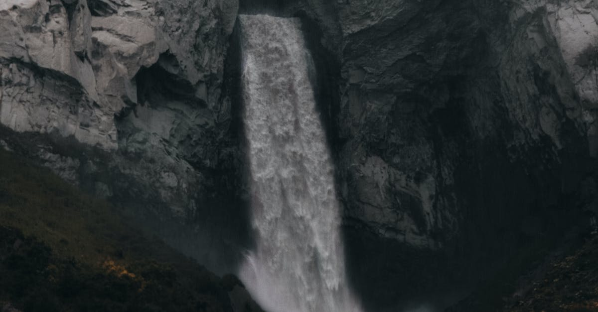 A large waterfall over a rock wall