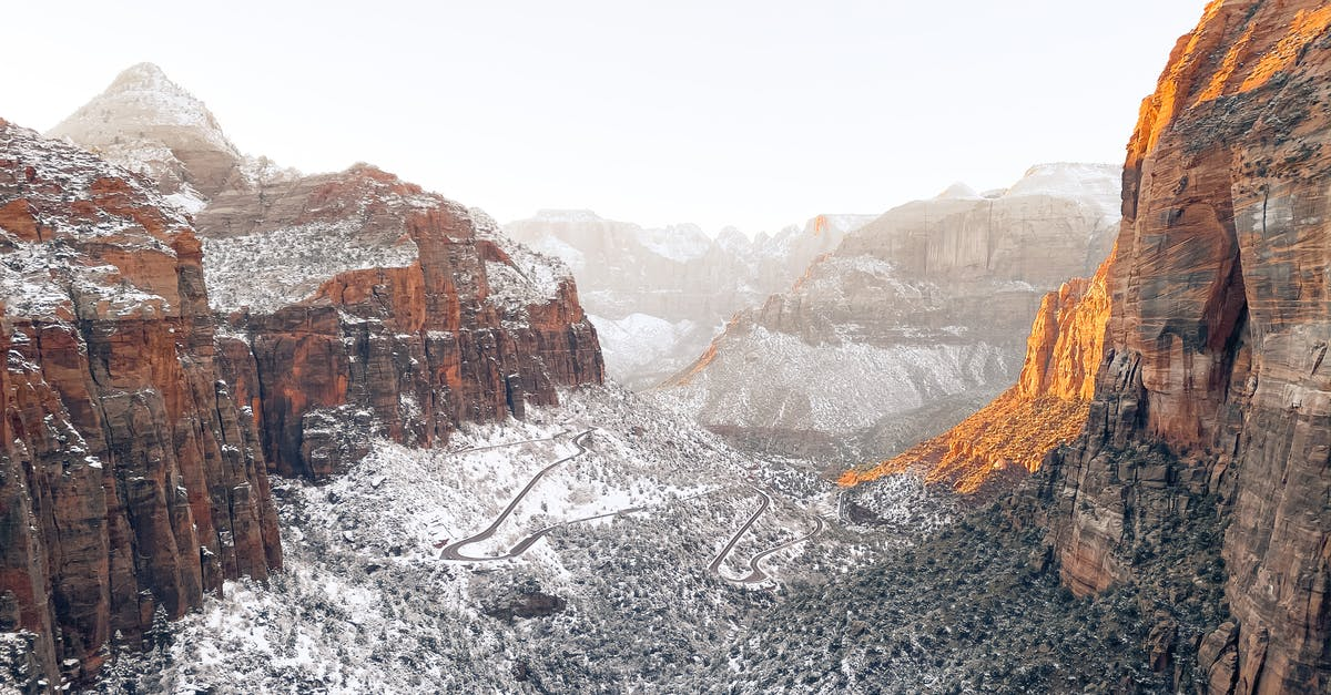 A canyon with a mountain in the snow