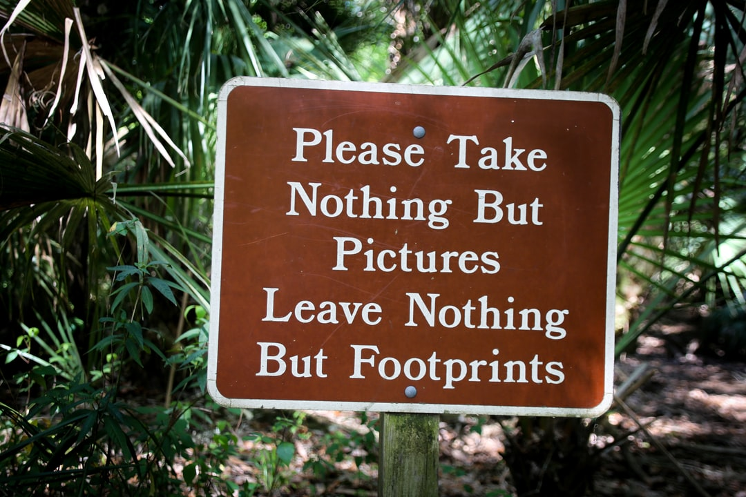 A sign in front of a tree