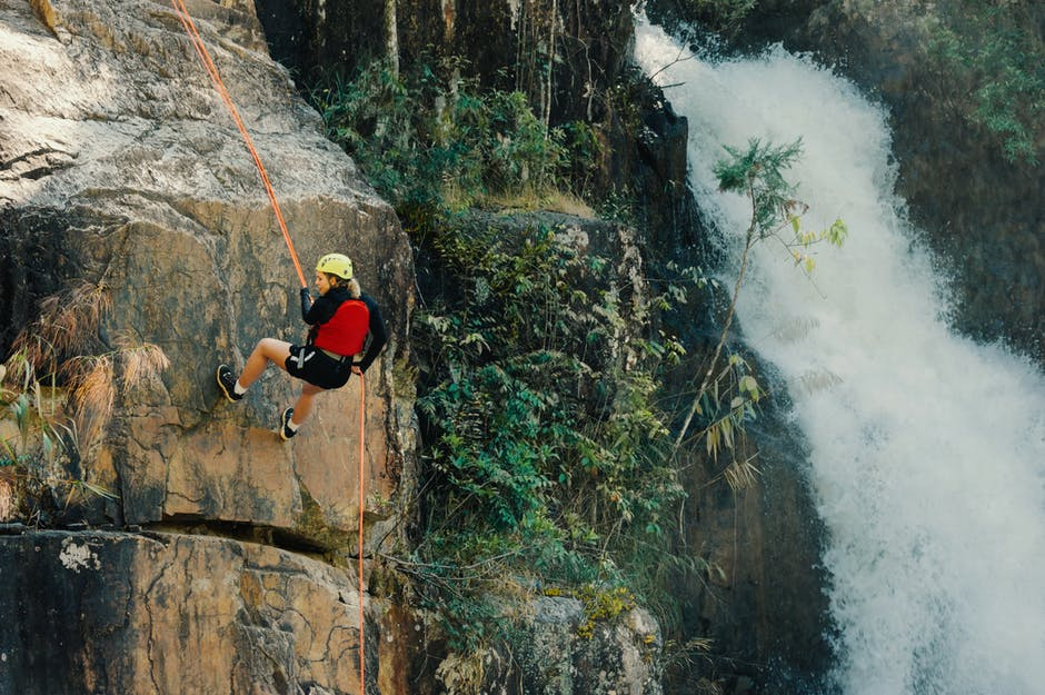 A person standing next to a waterfall